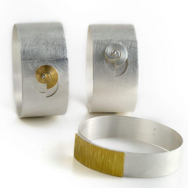 li: 925/-Silber, 750/-GG, Brill. 0,04ct.; vo: 925/-Silber, 900/-GG